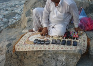 A vendor on the mountain sells mobile phones