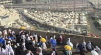 Pilgrims make their way to Mina on the opening morning of Hajj