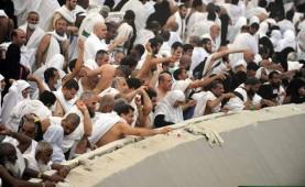 Pilgrims throw stones at the Jamaraat pillars - representing Satan